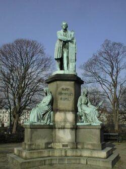 A monument memorizing H.C. Ørsted made by J.A. Jerichau (1816-1883) and assembled in Ørstedparken in Sølvgade